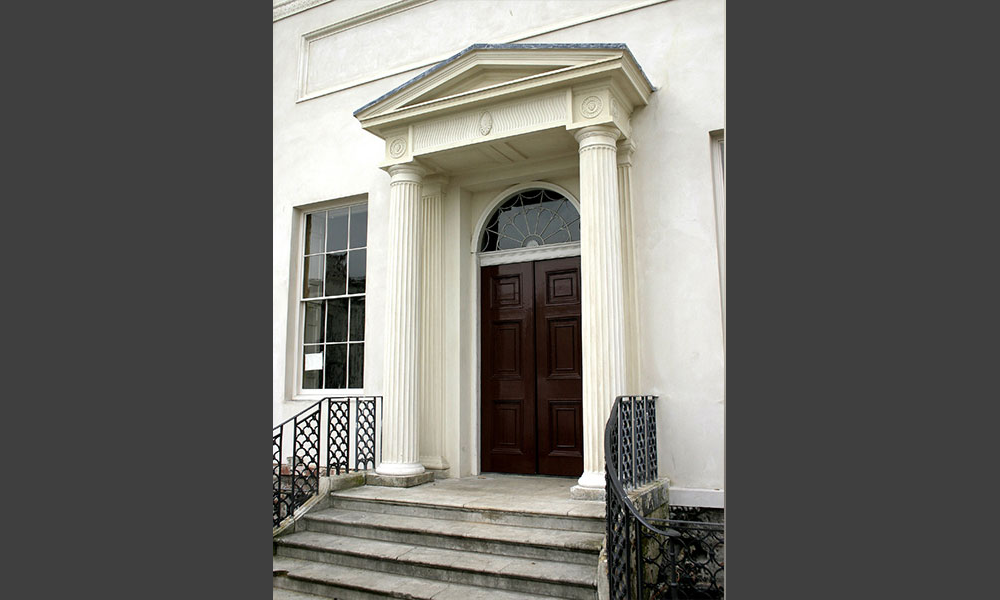 This important house was created out of local cottages by Robert Adam. The laminated columns and much else of the portico were falling to pieces, which we conserved. Of particular interest were the stucco roundels