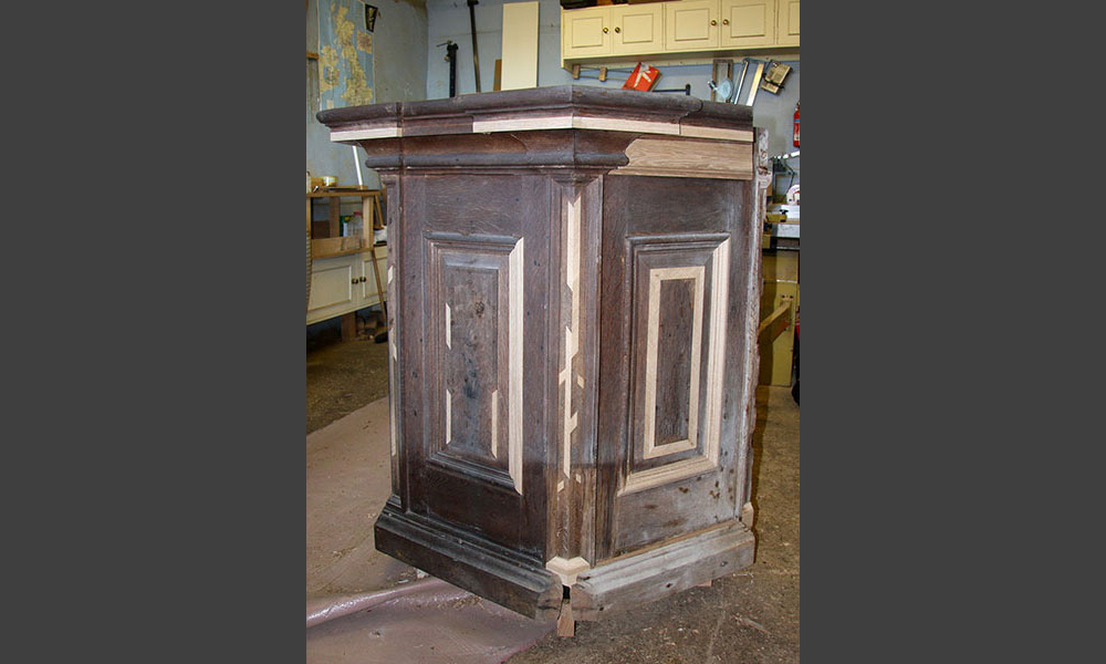 Mouldings and hand cut veneers replaced on pulpit.