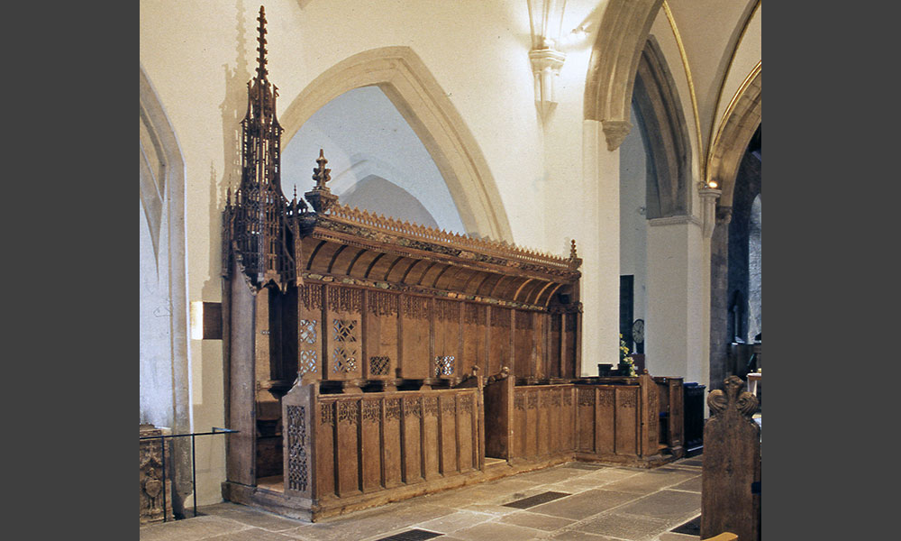 One of the best sets of choirstalls in Wales with unusually designed high stalls for the dignitaries at the east end.