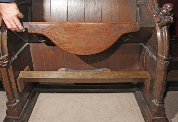 Bridge piece designed and constructed to prevent further misericord lamination, at Sherborne Abbey
